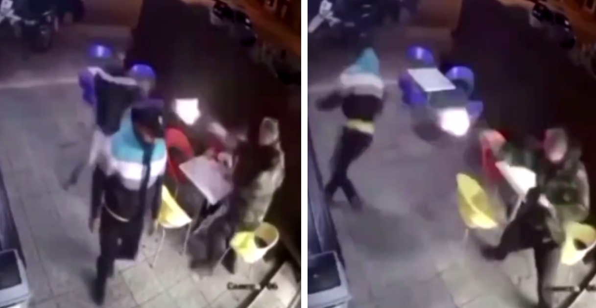 Video Shows Woman Casually Eating Her Ice Cream As Man Opens Fire On Two Men