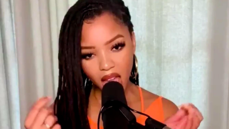 Chloe Bailey singing in orange