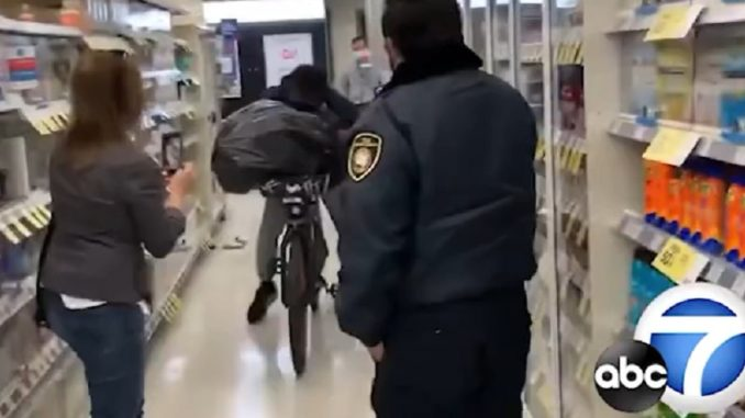 Thief Casually Fills His Garbage Bag Full Of Stolen Goods and Rides Out The Front Door