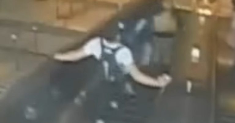 Surveillance Camera Captures Man 'Sparta Kick' 32-Year-Old Woman In The Chest & Down Escalator in NYC