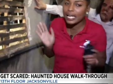 Reporter Gets Scared Af During A Haunted House Walk Through